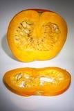 An half orange pumpkin with slice Royalty Free Stock Photography