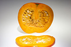 An half orange pumpkin with slice Royalty Free Stock Photography
