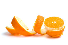 Half of an orange and some peel. Isolated on the white background Royalty Free Stock Photo