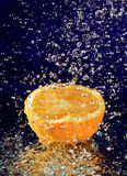 Half of orange with stopped motion water drops Stock Images