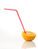 Half orange with straw. Isolated with reflection Royalty Free Stock Photos