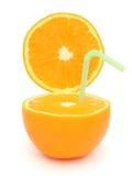 Half orange and straw Stock Photos