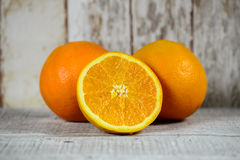 Half orange and two oranges Stock Photo