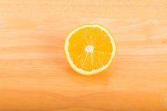 Half Orange on Wood Table Royalty Free Stock Photo