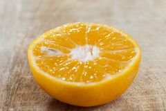 Half an oranges. With bones, cut with a knife and lying on a board royalty free stock photography