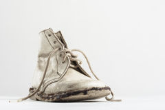 A half pair of old baby shoes  on white Royalty Free Stock Photo