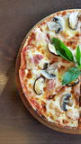 Half pan of Mushroom and Bacon Pizza. On wood table royalty free stock images