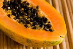 A half of papaya fruit. A half of fresh ,juicy papaya fruit royalty free stock images
