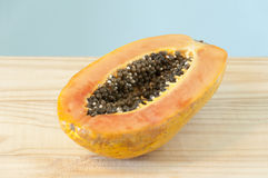 Half of papaya fruit stock photography