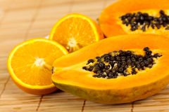 Half Papaya On A Wooden Background. Royalty Free Stock Images