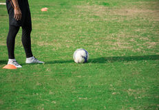 Half part of soccer player standing in football field Royalty Free Stock Photography