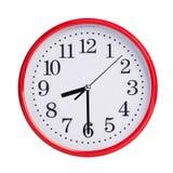 Half past eight on a round clock face stock photos