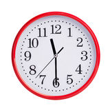 Half past eleven on a round dial Stock Photo