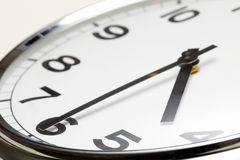 Half past four. Photo of clock showing half past four stock photography