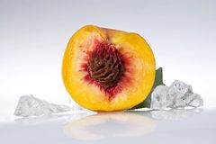 Half peach. And crushed ice cubes Stock Images