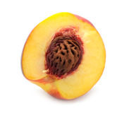 Half of Peach. A half of peach isolated on a white background stock image
