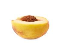 Half of a peach fruit isolated Royalty Free Stock Photos