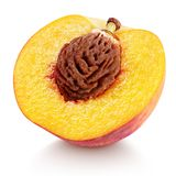 Half of peach fruit with nut isolated on white. Ripe half peach fruit with nut isolated on white background with clipping path. Full depth of field royalty free stock photo