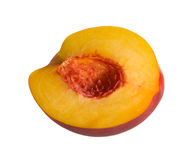 Half of the peach isolated on white. Sliced peach on white background Royalty Free Stock Photos