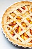 Half a peach pie Stock Photos