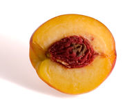 Half of the peach and stone. Half of the peach, front view Stock Images