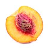 Half of peach on white Stock Photo