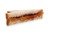 Half of a peanut butter and jelly sandwich. On a white background royalty free stock photography