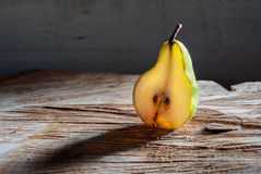 Half of pear glowing with light Stock Photos