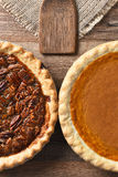 Half Pecan and Pumpkin Pies Stock Photography