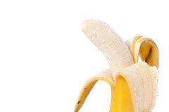 Half peeled banana isolated on white Clipping Path. Half peeled natural banana on a white Clipping Path royalty free stock photography