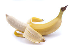 Half peeled banana. On white background Royalty Free Stock Images