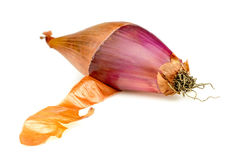 Half peeled purple onion Royalty Free Stock Photos