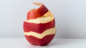 Half peeled red apple Royalty Free Stock Photo