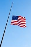 Half personalamerikanska flaggan Royaltyfria Bilder