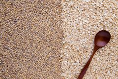 Half picture whole grain barley and half oatmeal cereal with wooden spoon, top view. Half picture whole grain barley and half oatmeal cereal with wooden spoon royalty free stock image
