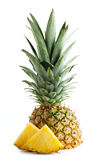 Half pineapple with leaves and cut pieces Royalty Free Stock Photos