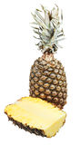 Half of pineapple and one ripe pineapple Royalty Free Stock Photo