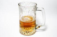 Half pint. Half empty or half full glass of lager Stock Photography