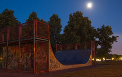 Half pipe by night. A half pipe by night in a deserted park Stock Photo
