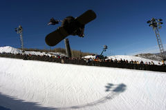 Half pipe snowboarder 1. A snowboarder at a halfpipe competition backside air Stock Images