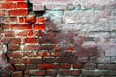 Half plastered distressed wall made of red bricks royalty free stock photo