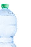 Half plastic bottle with water and drops, concept of nutrition and diet Stock Images