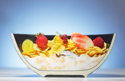 Half plate with corn flakes and fruit Royalty Free Stock Image