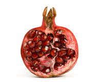 Half of pomegranate. On white background Stock Photos