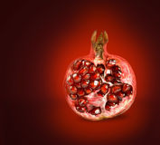 Half of pomegranate. On red background Stock Image