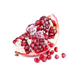 Half of pomegranate fruit over white Stock Images