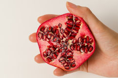 Half Pomegranate in hand Royalty Free Stock Image