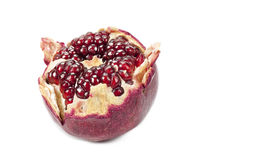 Half of a pomegranate. Isolated on a white background Royalty Free Stock Photography