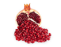 Half of pomegranate and pomegranate seeds Royalty Free Stock Images