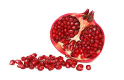 A half pomegranate with seeds (isolated) Stock Images